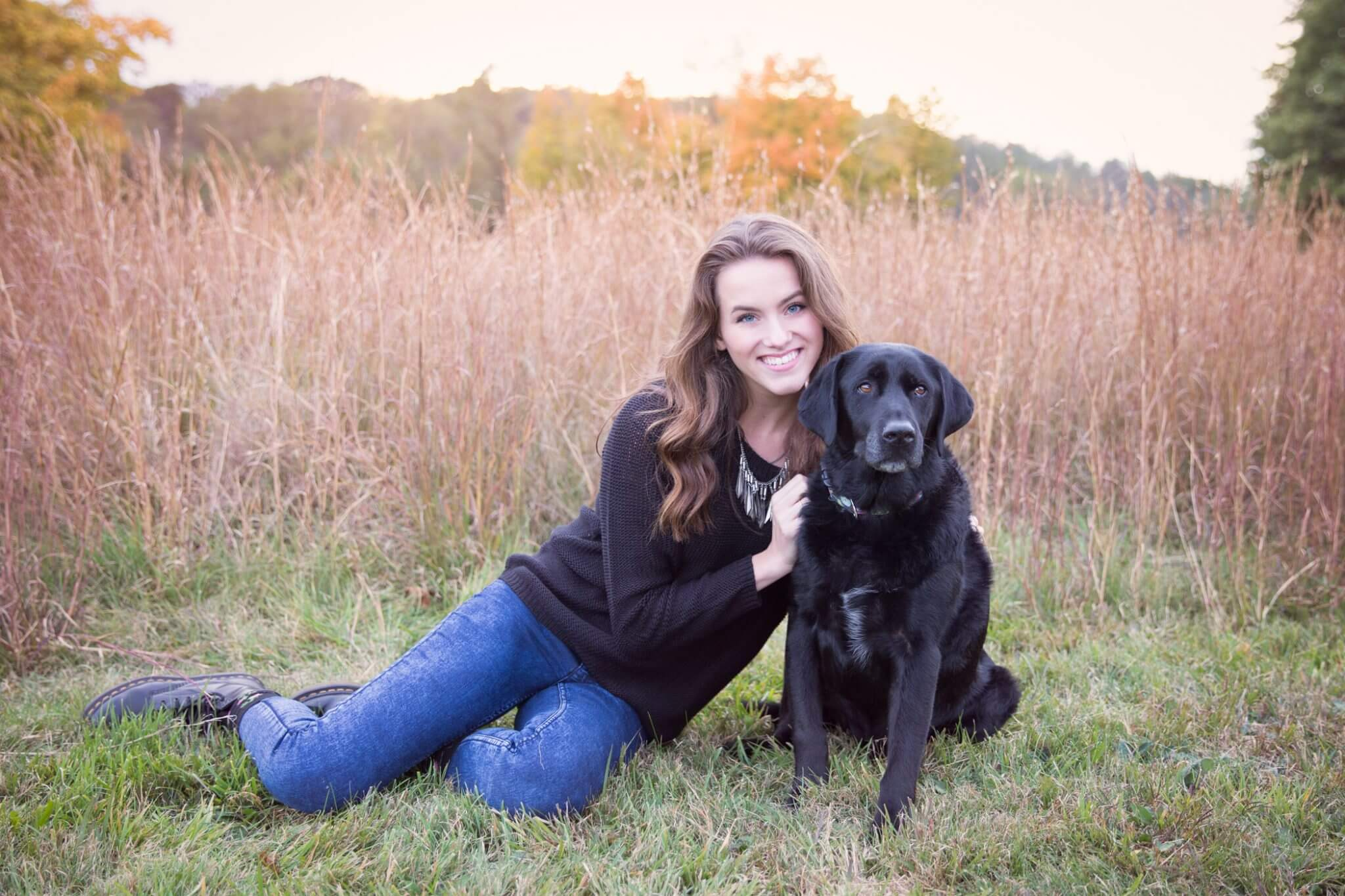 pittsburgh senior portrait in field with black lab dog